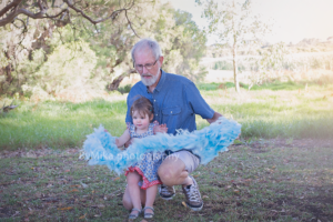 Grand dad and his grand daughter playing together during a photo session at Carine outdoor