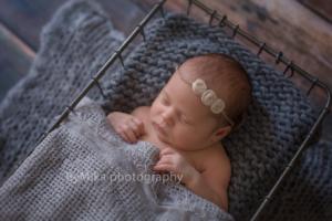 Newborn baby portrait in prop