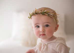 Baby looking in camera with Christmas headband
