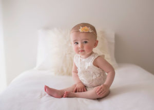 7 month old baby on bed in studio