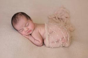 Tummy posing newborn baby