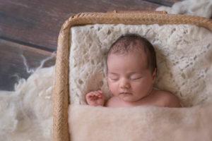 Baby in basket asleep