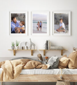 Boys bedroom with family photos on the wall